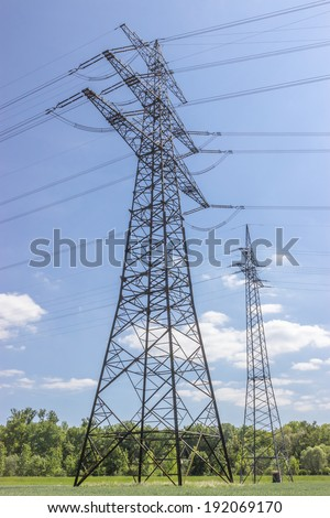 Power pole of a power line - stock photo