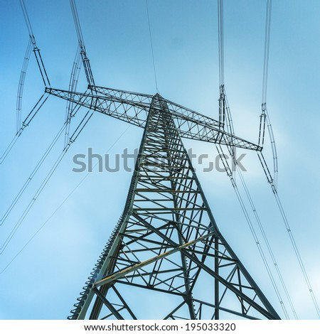 power pole with cloudy dynamic sky - stock photo