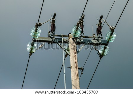 Power pole with lightning conductors and glass insulation