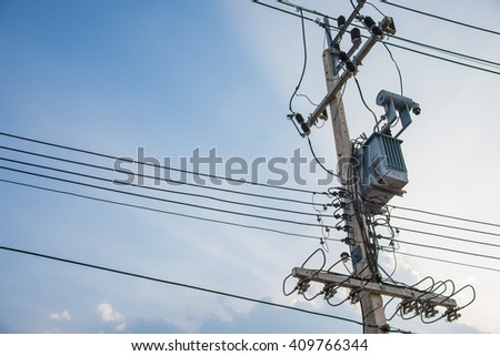 Power poles with wires and blue sky