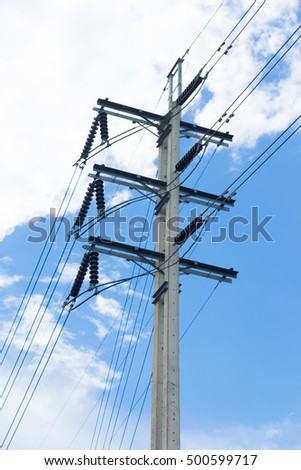 Power poles with wires connected later. Behind the sky