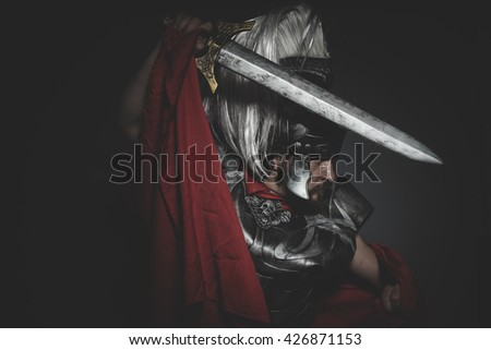 Power, Praetorian Roman legionary and red cloak, armor and sword in war attitude