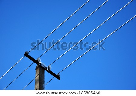 Power pylon cable under blue sky