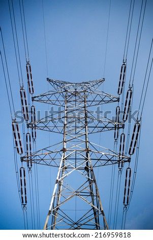 power pylons and wires during sunny day - stock photo