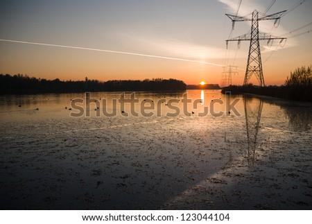 Power pylons in landscape - stock photo
