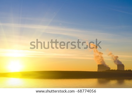Power station against the sunrise - stock photo