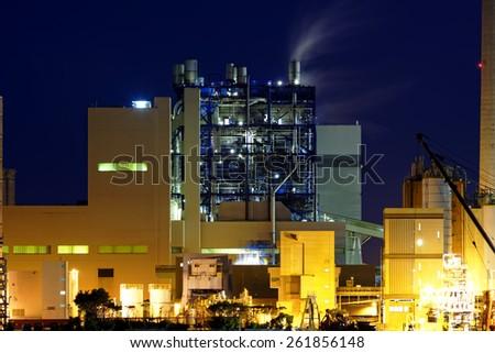 power station at night with smoke , hong kong - stock photo