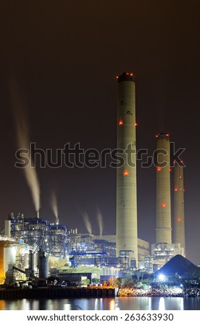 power station at night with smoke, hong kong - stock photo