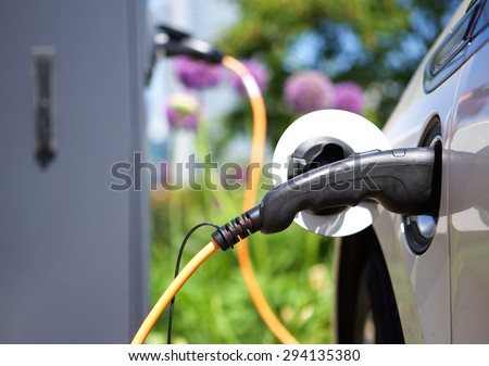 Power supply for hybrid electric car charging battery - stock photo
