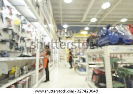 Power tools hardware store, blurred image background  - stock photo