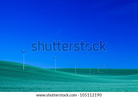 Power-transmission poles on the empty barley field at night - stock photo