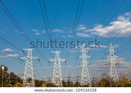 Power transmission tower against the blue sky background. - stock photo