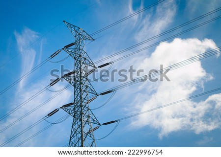 power transmission tower on cloud and sky background - stock photo