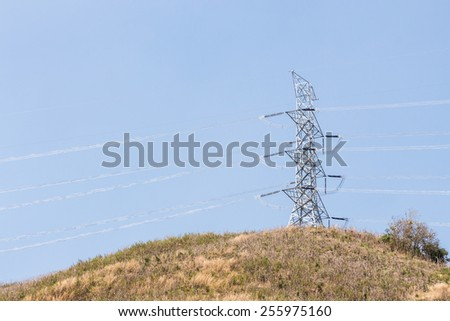 Power transmission tower on dry mountain. - stock photo
