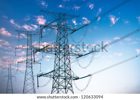 power transmission tower with sunset sky - stock photo