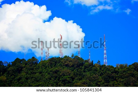 Power transmission towers on the hill - stock photo