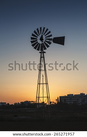 Power windmill against a sunset sky in rural areas