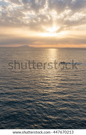 Powerboat in the sunset. Sorrento. Italy.