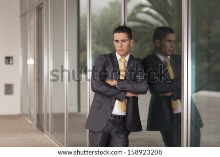 Powerful and elegant businessman at the exterior of his office - stock photo