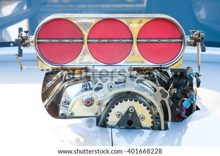 powerful blower supercharger on a high performance racing vehicle - stock photo