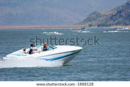 Powerful boat on mountain lake. - stock photo