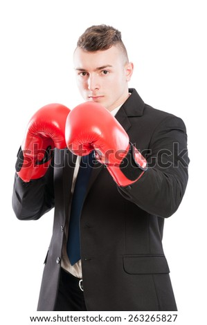 Powerful business man wearing red boxing gloves and black elegant suit and tie