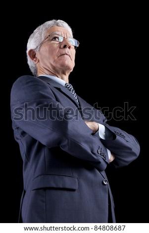 Powerful businessman portrait (isolated on black) - stock photo