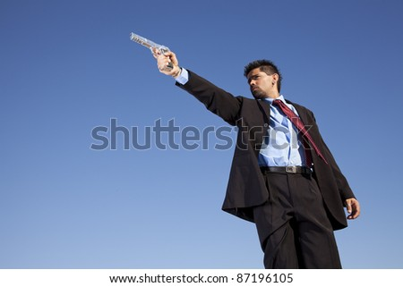 Powerful businessman with a gun in outdoor