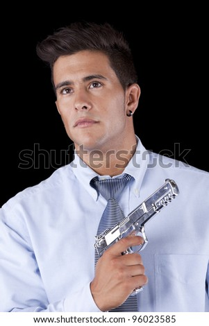 Powerful businessman with a gun (isolated on black) - stock photo