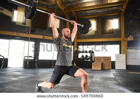 Powerful crossfit athlete overhead lunge heavy stock photo 549704860 powerful crossfit athlete in a over head lunge with a heavy weight in a cross platinumwayz