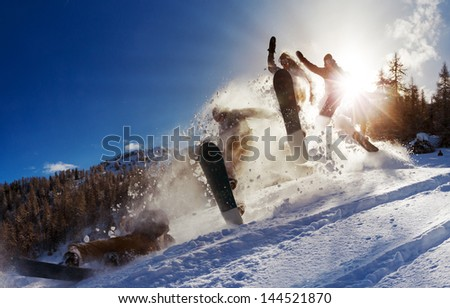 Powerful image of a snowboarder jumping over a kicker in the backcountry powder - stock photo