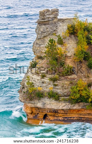 Powerful Lake Superior waves crash at the base of Miners Castle, a rock formation in Upper Peninsula Michigan's Pictured Rocks National Lakeshore. - stock photo