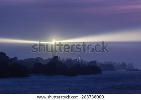 Powerful lighthouse illuminated at night,Ushant island, France - stock photo
