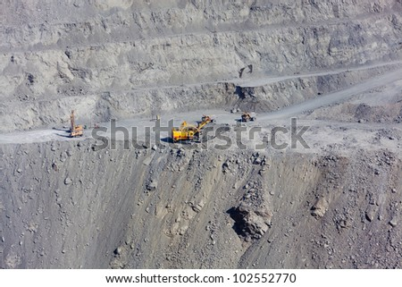 powerful machinery working at the open stone quarry - stock photo