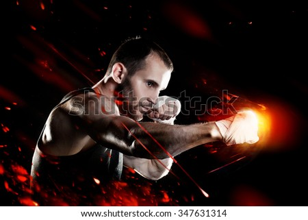 Powerful  muscular man, strong punch, fire effect - stock photo