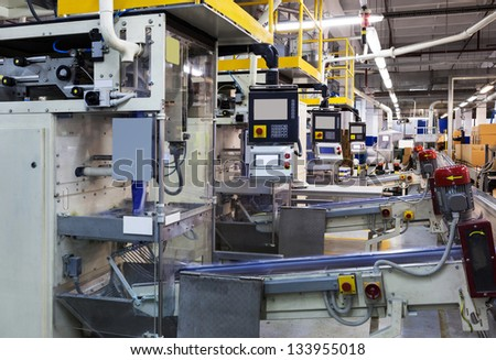 powerful new conveyor in modern plant - stock photo