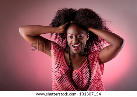 powerful portrait of a beautiful black woman screaming - stock photo