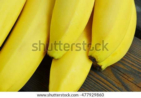 Powerful Reasons to Eat Bananas. colorful of bananas on wooden background.