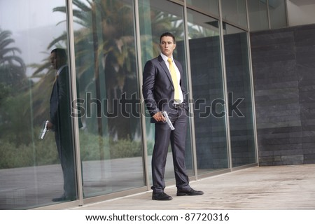 Powerful security businessman with a gun