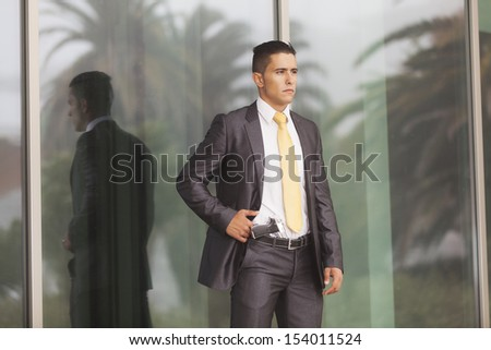 Powerful security businessman with a handgun in his belt  - stock photo