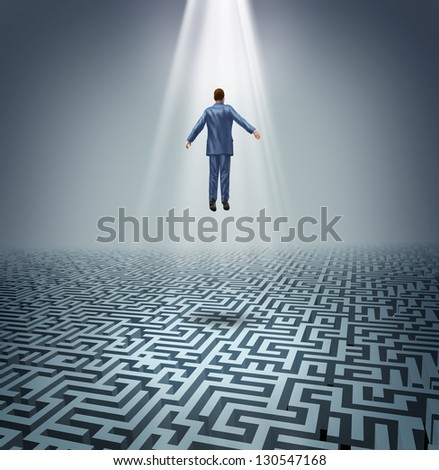 Powerful solutions with a businessman levitating above a maze or labyrinth as a business concept of leadership and conquering challenges and obstacles with a man rising above to find the answers. - stock photo