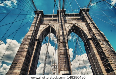 Powerful structure of Brooklyn Bridge Center Pylon on a beautiful summer day. - stock photo