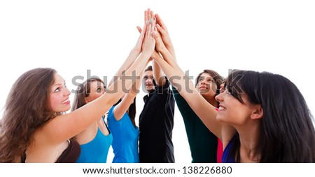 Powerful team members' hands together showing unity.