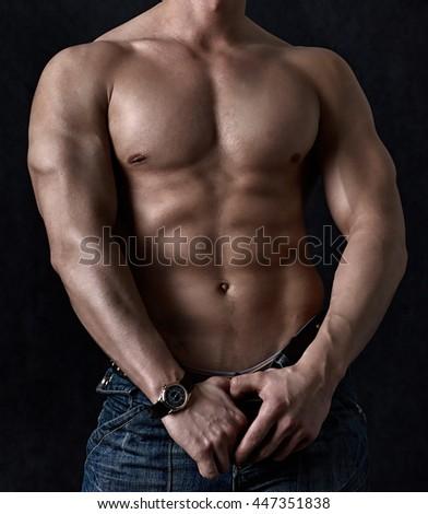 Powerful torso on black background - stock photo