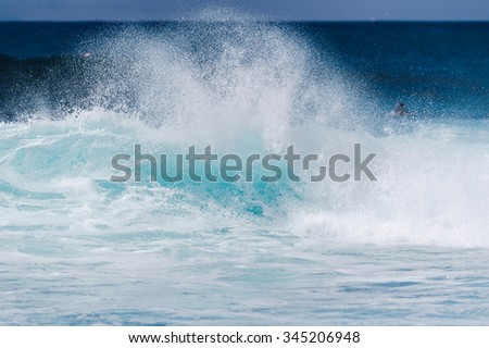 Powerful wave breaks along the shore - stock photo