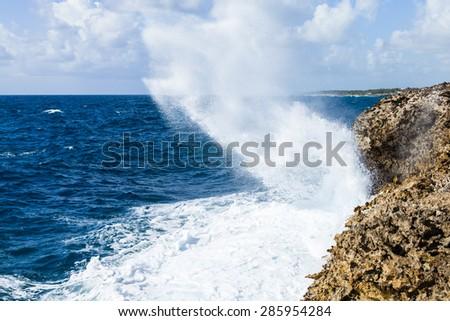 Powerful Waves crushing on a rocky beach. - stock photo
