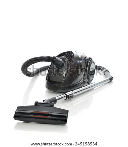 Powerfull black Vacuum cleaner on the floor isolated on the white background
