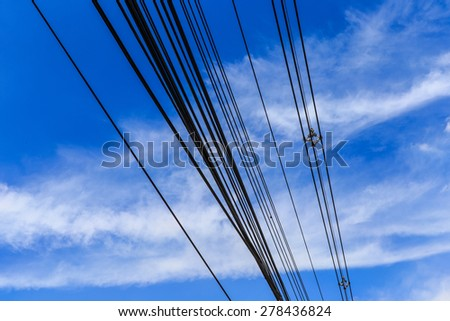 Powerline on blue sky background - stock photo