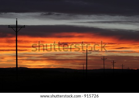 powerlines along the roadside at sunset
