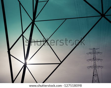 Powerlines in morning sun - stock photo